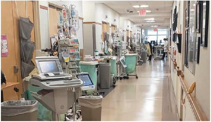 Figure 1. Pumps lined up outside patient rooms in a hospital ICU (March 2020).