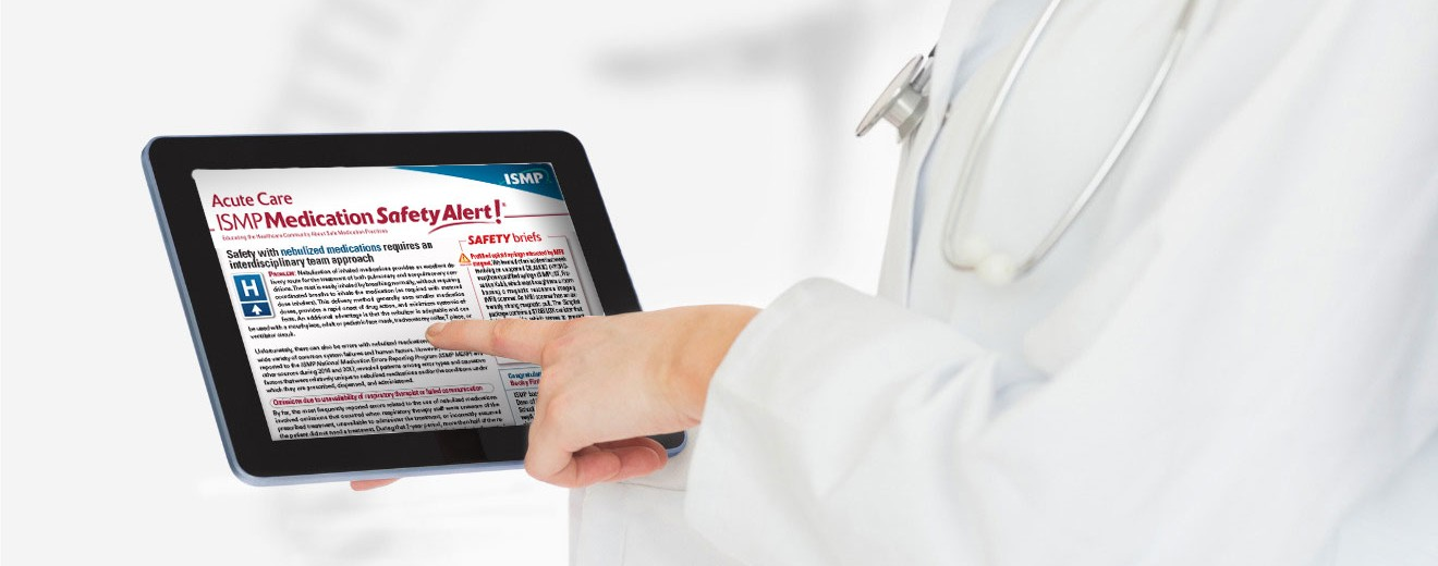 healthcare practitioner reading the ISMP Medication Safety Alert! on a digital tablet