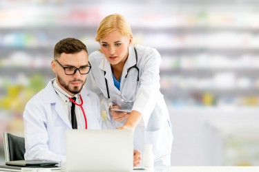healthcare professionals looking at computer